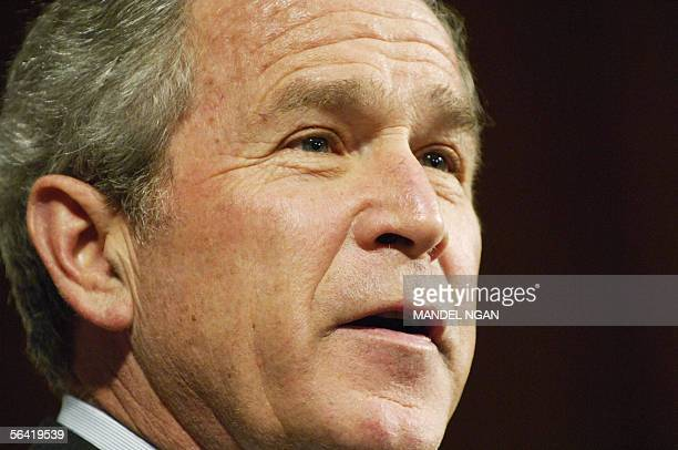 US President George W Bush speaks 12 December 2005 at a hotel in Philadelphia Pennsylvania Three days before Iraq's critical elections US President...
