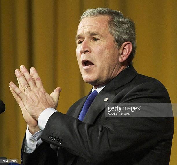 US President George W Bush speaks to the World Affairs Council of Philadelphia 12 December 2005 at a hotel in Philadelphia Pennsylvania Bush is...