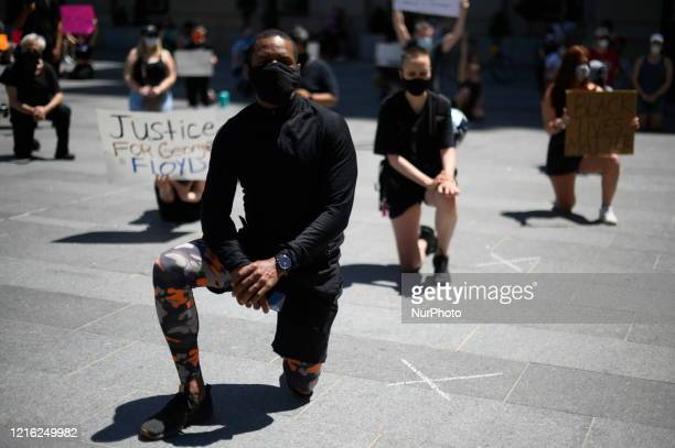 Philadelphians takes a knee during a nine minutes long vigil for George Floyd as thousands around the nation protest police brutality during similar...