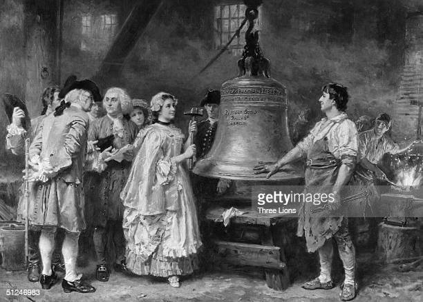 1753 Philadelphia's Liberty Bell being tested in the Pass and Stow Foundry with the American statesman writer and scientist Benjamin Franklin present...