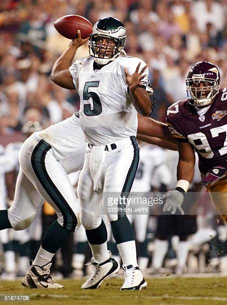 Philadephia Eagles' quarterback Donovan McNabb throws against the Washington Redskins in the first quarter of action 16 September 2002 at FedEx Field...