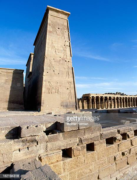 Philae viewed from the Nile The main Pylon and the west colonnade hall of the temple of IsisThe construction of the temple started during the reign...
