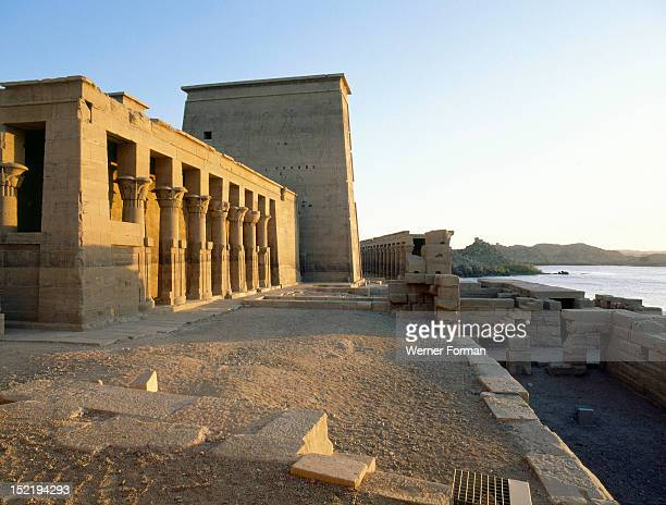 Philae viewed from the NileThe west colonnade hall of the Temple of Isis The construction of the temple started during the reign of Ptolemy II...