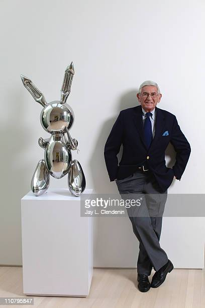 Philanthropist and renowned art collector Eli Broad is photographed in his Los Angeles home with TITLE OF WORK Koons Jeff Rabbit stainless steel 41 x...