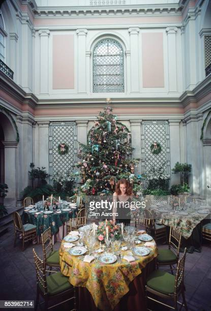 Philanthropist Ann Getty wife of millionaire oil tycoon Gordon Getty decorating tables for a Christmas celebration at their home in Pacific Heights...
