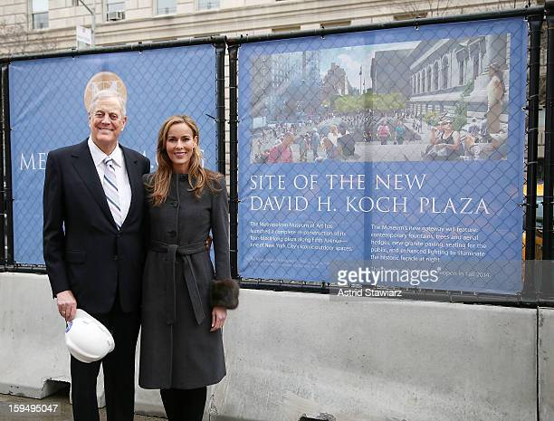 Philanthropist David H Koch and wife Julia Koch stand in the future site of the new David H Koch Plaza during the Fifth Avenue Plaza Groundbreaking...