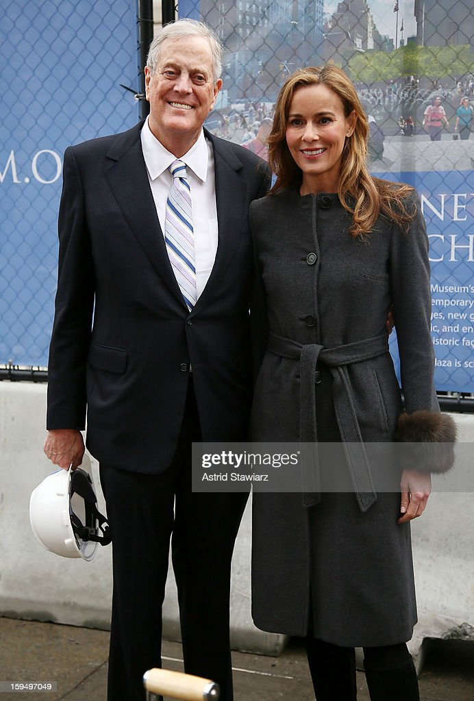 Philanthropist David H. Koch and wife Julia Koch stand in the future site of the new David H. Koch Plaza during the Fifth Avenue Plaza Groundbreaking at the Metropolitan Museum of Art on January 14, 2013 in New York City.
