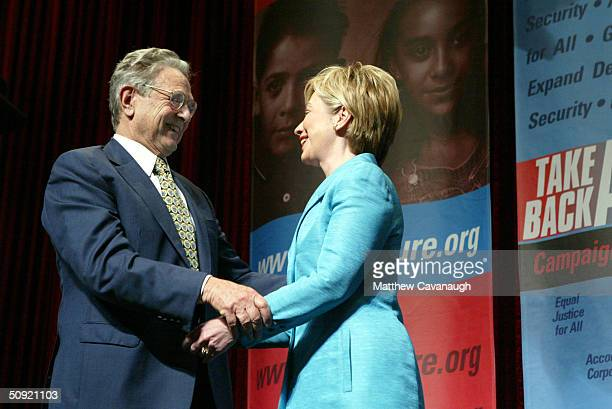Philanthropist George Soros greets US Senator Hillary Clinton after she introduced him at the Take Back America Conference June 3 2004 in Washington...