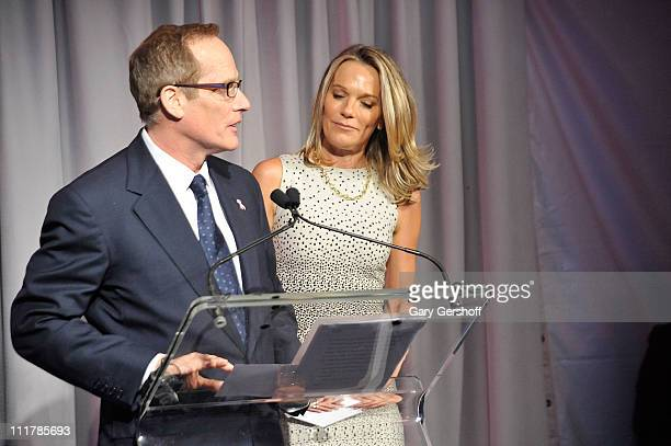 Philanthropist Glenn R Dubin speaks to invited guests while Dr Eva AnderssonDubin looks on at the opening of Dubin Breast Center at the Tisch Cancer...