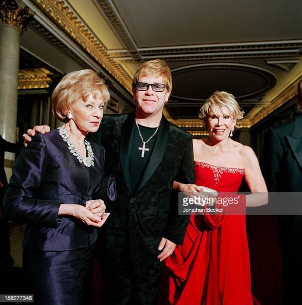Philanthropist Lily Safra singer Elton John and comedian Joan Rivers are photographed for Vanity Fair Magazine on June 21 2003 at Buckingham Palace...