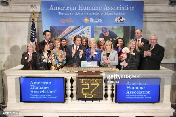 Philanthropist Lois Pope joined by country music singer and activist Naomi Judd American Humane Association President CEO Robin Ganzert and her small...