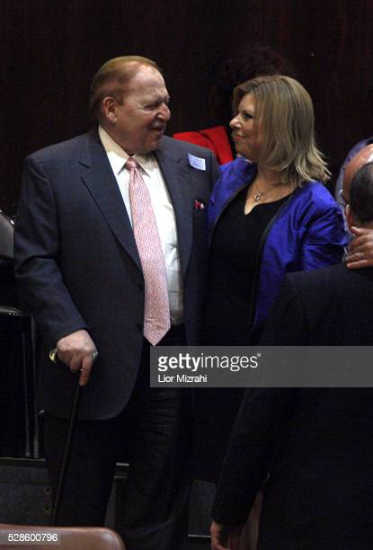 Philanthropist Sheldon Adelson hugs Sara Netanyahu wife of Israeli Prime Minister Benjamin Netanyahu during the swearing of a new government in the...
