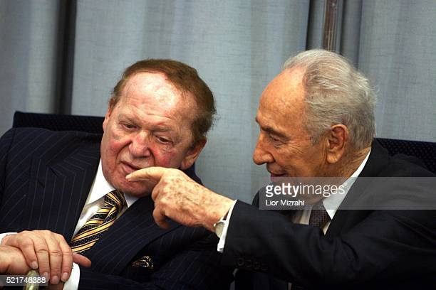 Philanthropist Sheldon Adelson speaks to Israeli President Shimon Peres during a ceremony in The President house on August 12 2007 in Jerusalem Israel