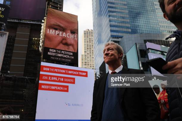 Philanthropist Tom Steyer stands in front of one of the billboards he has funded in Times Square calling for the impeachment of President Donald...