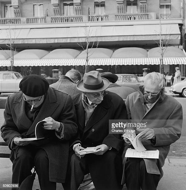 Philatelists gathere at Rond Pint on the Champs Elysee a well known weekly meeting place for stamp collectors mid 1960s