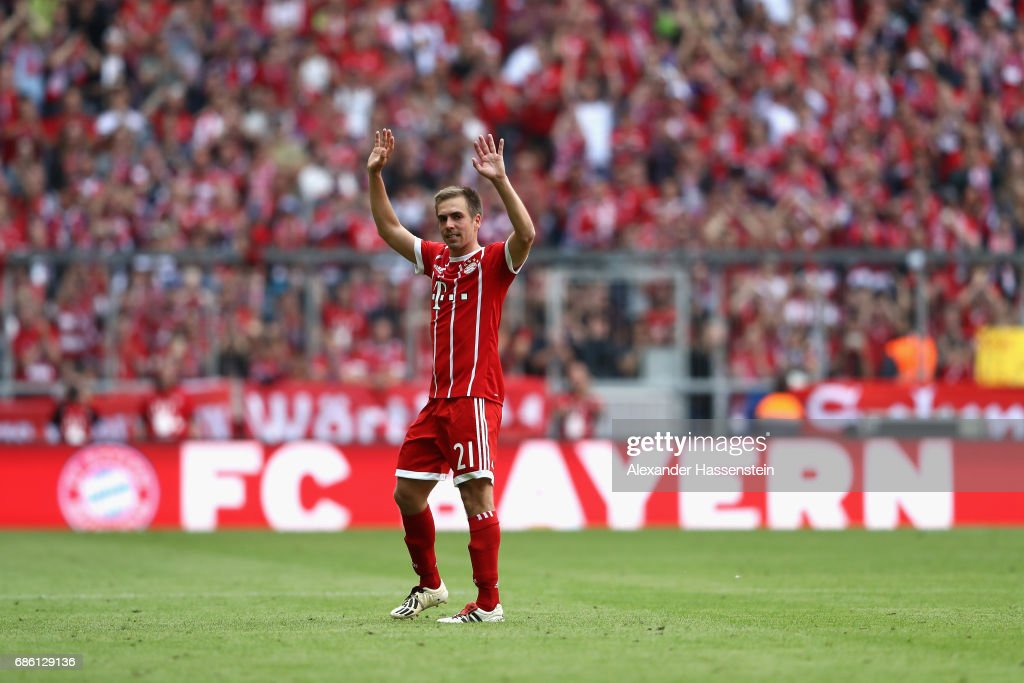 Philiip Lahm of Bayern Muenchen leaves the field of play and is substituted on his last match during the Bundesliga match between Bayern Muenchen and SC Freiburg at Allianz Arena on May 20, 2017 in Munich, Germany.