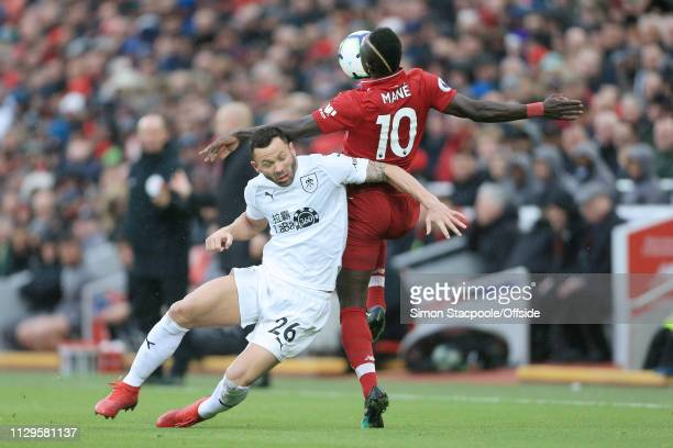 Philip Bardsley of Burnley battles with Sadio Mane of Liverpool during the Premier League match between Liverpool and Burnley at Anfield on March 10...