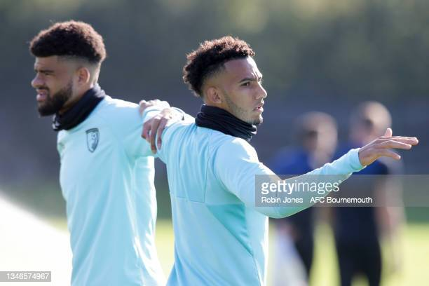 Philip Billing and Lloyd Kelly of Bournemouth during a training session at the Vitality Stadium on October 14, 2021 in Bournemouth, England.