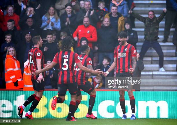 Philip Billing of AFC Bournemouth celebrates with his team mates after scoring his team's first goal during the Premier League match between AFC...