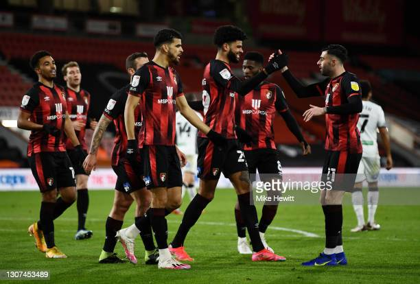 Philip Billing of AFC Bournemouth celebrates with team mate Diego Rico after scoring their side's first goal during the Sky Bet Championship match...