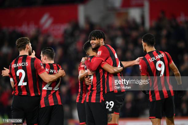Philip Billing of AFC Bournemouth celebrates with teammates after scoring his team's first goal during the FA Cup Third Round match between AFC...