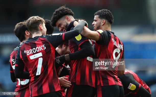Philip Billing of AFC Bournemouth celebrates with teammates after scoring their team's first goal during the Sky Bet Championship match between...