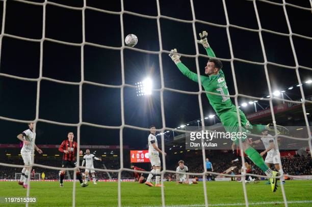 Philip Billing of AFC Bournemouth scores his team's first goal past Simon Sluga of Luton Town during the FA Cup Third Round match between AFC...