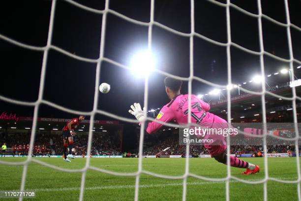 Philip Billing of AFC Bournemouth scores the winning penalty in the penalty shootout during the Carabao Cup Second Round match between AFC...