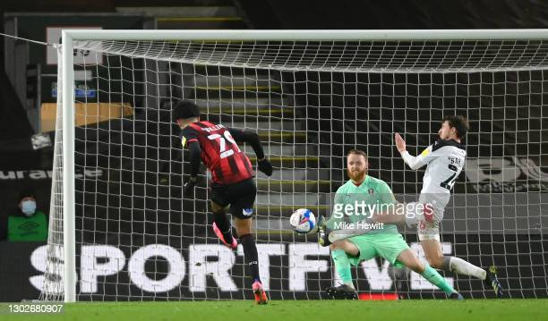 Philip Billing of AFC Bournemouth scores their side's first goal past Dan Barlaser and Viktor Johansson of Rotherham United during the Sky Bet...