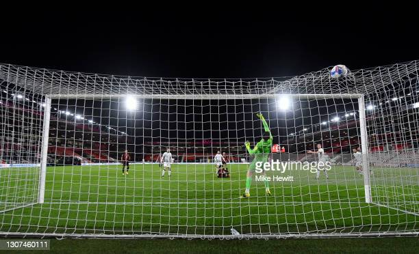Philip Billing of AFC Bournemouth scores their side's first goal past Freddie Woodman of Swansea City during the Sky Bet Championship match between...
