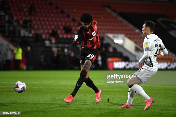 Philip Billing of AFC Bournemouth takes a shot whilst under pressure from Connor Roberts of Swansea City during the Sky Bet Championship match...