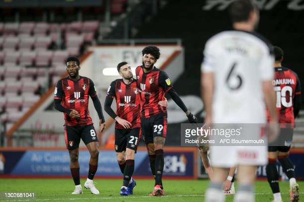 Philip Billing of Bournemouth celebrates with team-mates Jefferson Lerma and Diego Rico after he scores a goal to make it 1-0 during the Sky Bet...