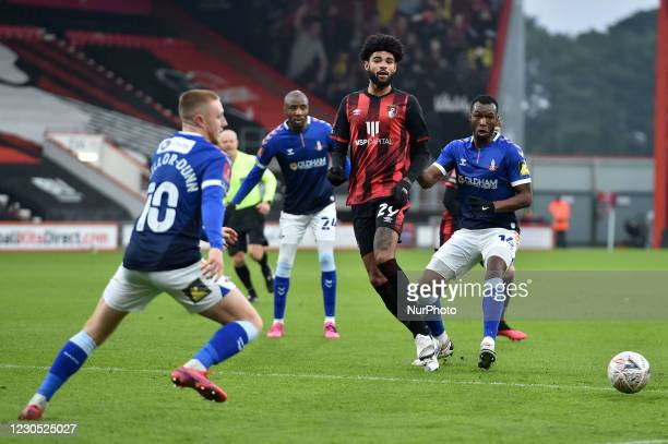 Philip Billing of Bournemouth tussles with Oldham Athletic's Brice Ntambwe during the FA Cup match between Bournemouth and Oldham Athletic at the...