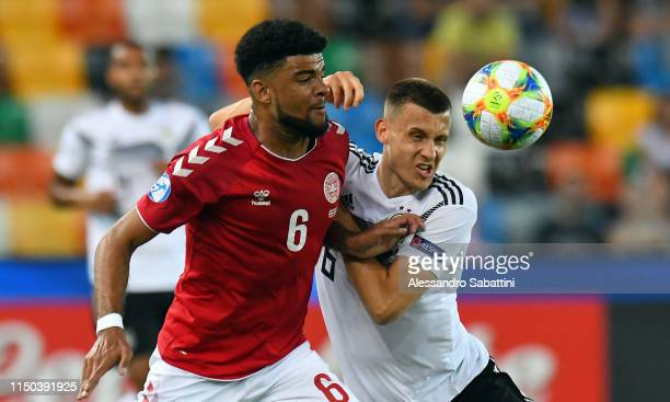 Philip Billing of Denmark competes for the ball with Maximilian Eggestein of Germany during the 2019 UEFA U21 Group B match between Germany and...
