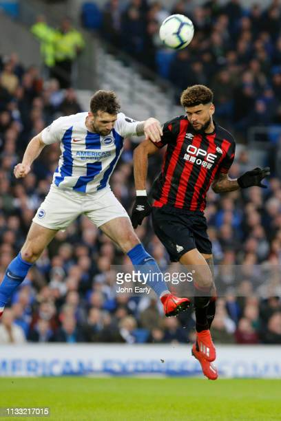 Philip Billing of Huddersfield Town and Dale Stephens of Brighton Hove Albion during the Premier League match between Brighton Hove Albion and...