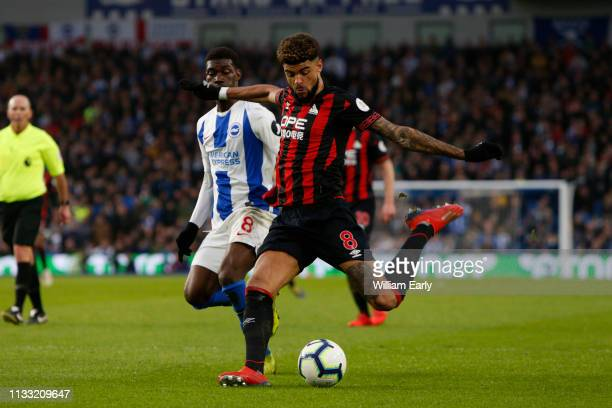 Philip Billing of Huddersfield Town and Yves Bissouma of Brighton Hove Albion during the Premier League match between Brighton Hove Albion and...