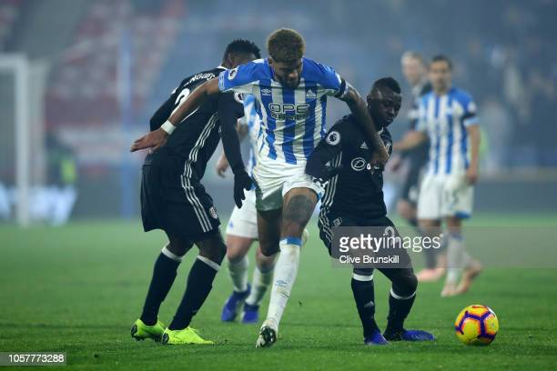 Philip Billing of Huddersfield Town battles for possession with Jean Michael Seri of Fulham and AndreFrank Zambo Anguissa of Fulham during the...