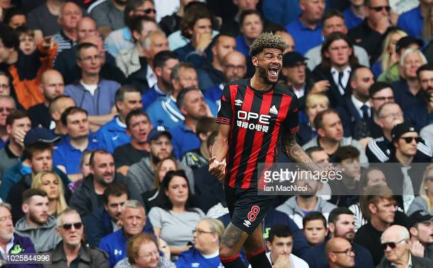 Philip Billing of Huddersfield Town celebrates after he scores the opening goal during the Premier League match between Everton FC and Huddersfield...