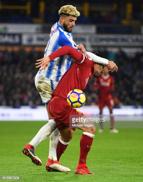 Philip Billing of Huddersfield Town fouls Emre Can of Liverpool to concede a penalty during the Premier League match between Huddersfield Town and...