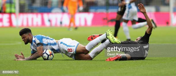 Philip Billing of Huddersfield Town is tackled by Isaac Hayden during the Premier League match between Huddersfield Town and Newcastle United at John...