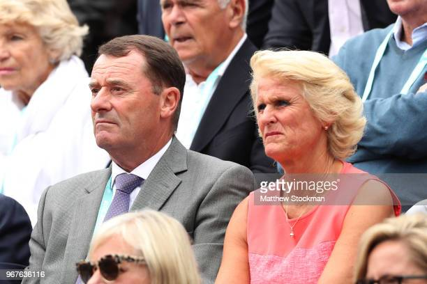 Philip Brook and wife Gill Brook watch on during the mens singles quarter final match between Alexander Zverev of Germany and Dominic Thiem of...