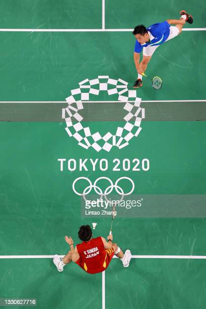 Philip Chew and Ryan Chew of Team United States compete against Takeshi Kamura and Keigo Sonoda of Team Japan during a Men's Doubles Group C match on...