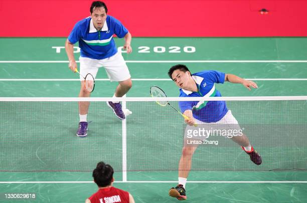 Philip Chewand Ryan Chew of Team United States compete against Takeshi Kamura and Keigo Sonoda of Team Japan during a Men's Doubles Group C match on...