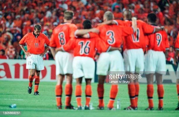 Philip Cocu of Holland walks back to his team after missing the second penalty for the Dutch team.The Semi Final of the World Cup between Brazil and...
