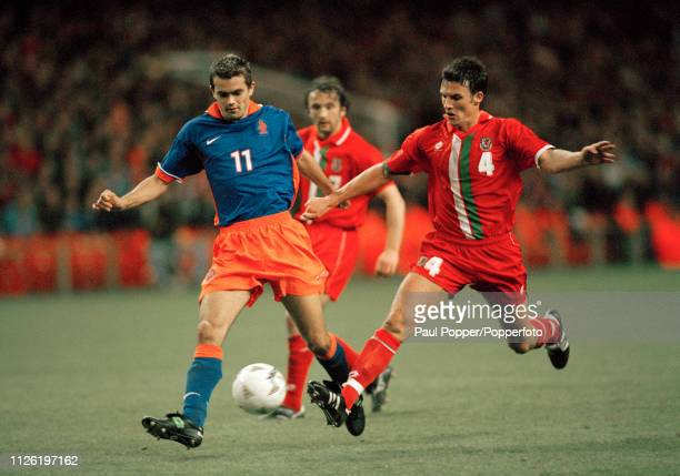 Philip Cocu of the Netherlands and Trevor Browning of Wales battle for the ball during a 1998 FIFA World Cup Qualifying match at the Cardiff Arms...