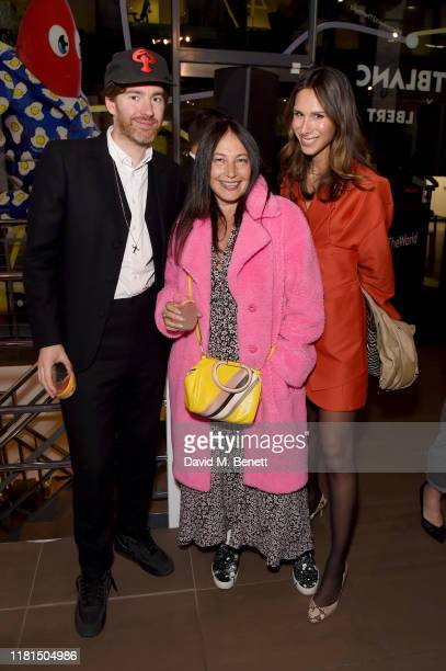Philip Colbert, Sara Blonstein and Isabella Charlotta Poppius attend a celebration of In Transit, an immersive retail pop-up in East London with...