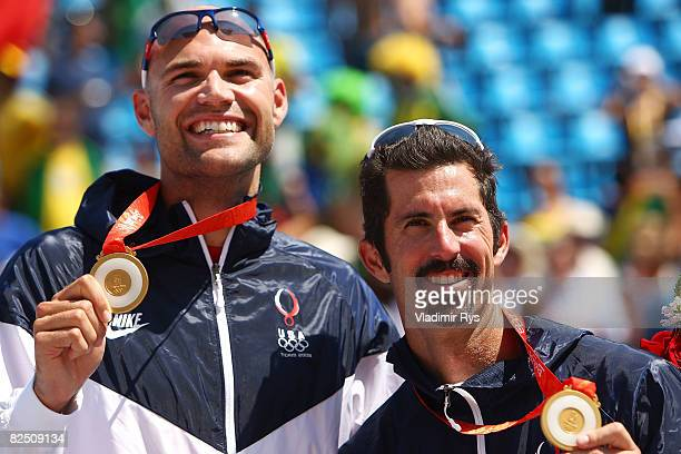 Philip Dalhausser and Todd Rogers of the United States celebrate their win over Brazil for the gold medal in beach volleyball game at the Chaoyang...
