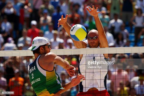 Philip Dalhausser of the United States blocks a shot from Fabio Magalhaes of Brazil during the gold medal beach volleyball game at the Chaoyang Park...