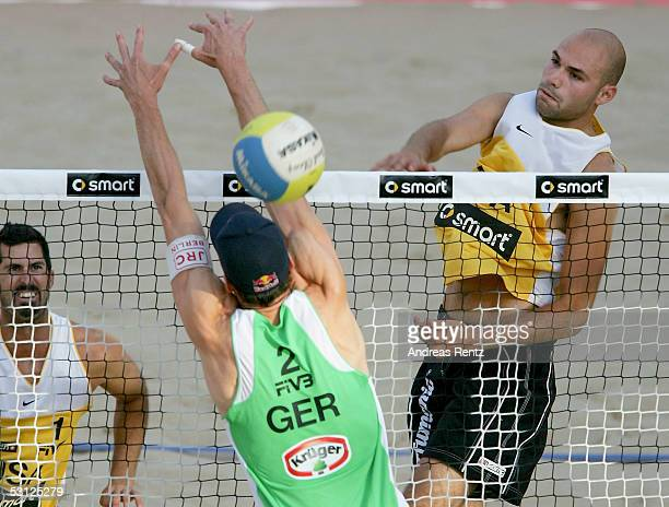Philip Dalhausser of USA challenges with Andreas Scheuerpflug of Germany during the second round match between Todd Rogers and Philip Dalhausser of...