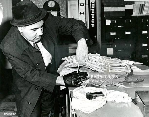 Philip DiNatale of Boston Police with the eight shot Brevettais that was found in Albert DeSalvo's room where he was hiding in Lynn Mass Feb 27 after...